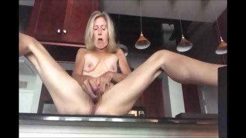 Blonde milf masturbating in the kitchen and cum