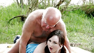 Chubby Brunette Teen Sucks And Fucks An Old Fart's Cock Outdoors