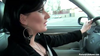 This gorgeous brunette slut is so horny that it is scary. She is driving her boyfriend back home. She loves the fact that his cock is pretty hard; it