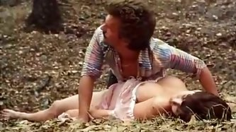Kinky big breasted sleepy brunette lies on the cold ground in the park. Two buddies find this lewd busty nympho and wake her up by drilling her hairy