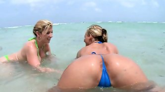 Sexy blondes Sara Jay and Phoenix Marie enjoy nice beach and show off their goodies. When it gets boring without cock, they come out of ocean and sati