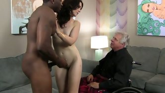 Attractive brunette chick with pale skin sucks delicious bbc in front of her cuckold husband. The paralyzed man lciks her muff and toes with desire an